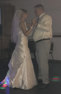 Mike dancing with his daughter
